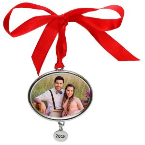 Create a annual Christmas ornament that features a family photo to brighten your holiday decor.