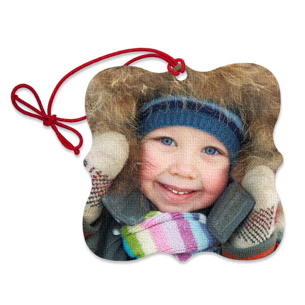 Add your photo to a personalized ornament perfect for hanging on your tree or giving as a gift