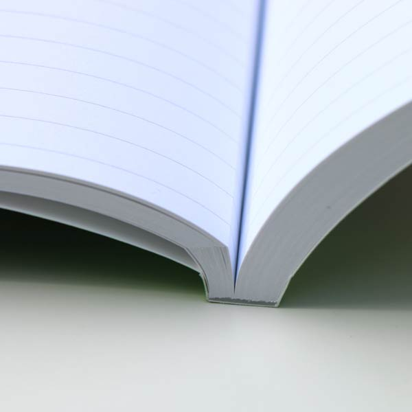 Photo personalized paperback journals are professionally press bound
