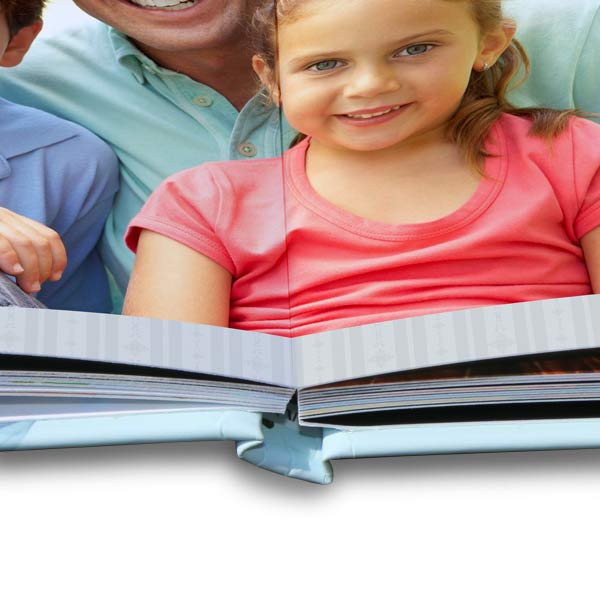 Professionally printed lay flat photo books with full spread layouts and quality binding