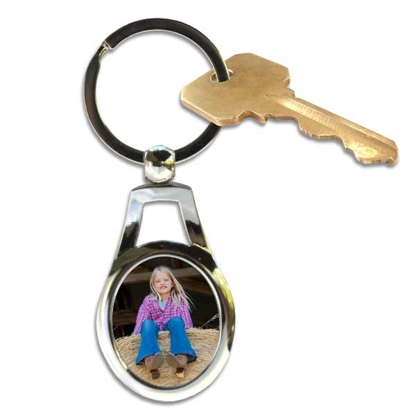 Customize your own key ring shaped like an oval, just add your own picture