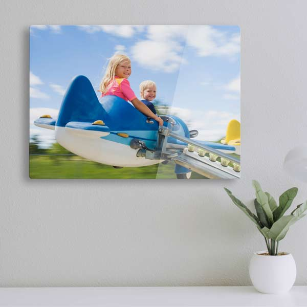 Modern glossy acrylic photo panel floating from wall