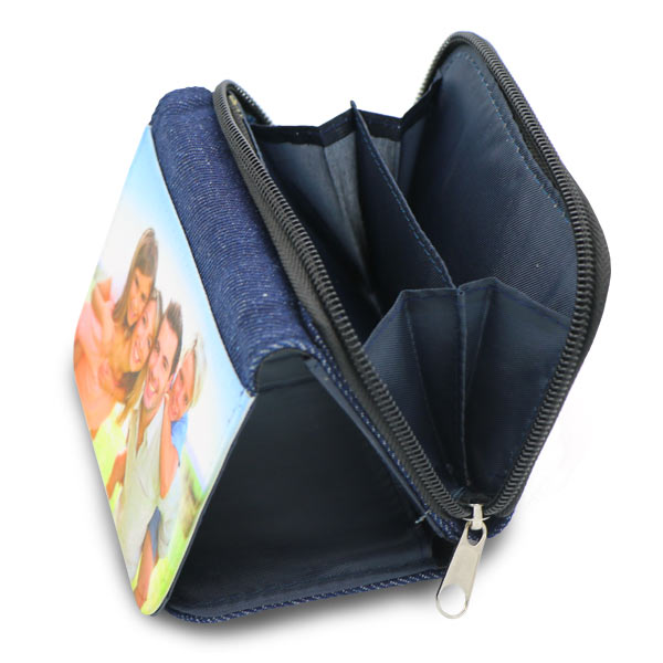 Zippered compartment on denim wallet is ideal for holding change and coins