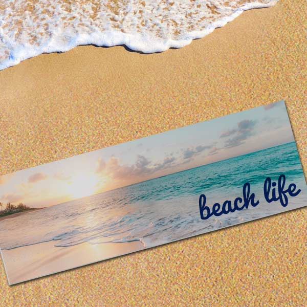 Design your own beach mat by adding photos and text and show off your memories at the beach